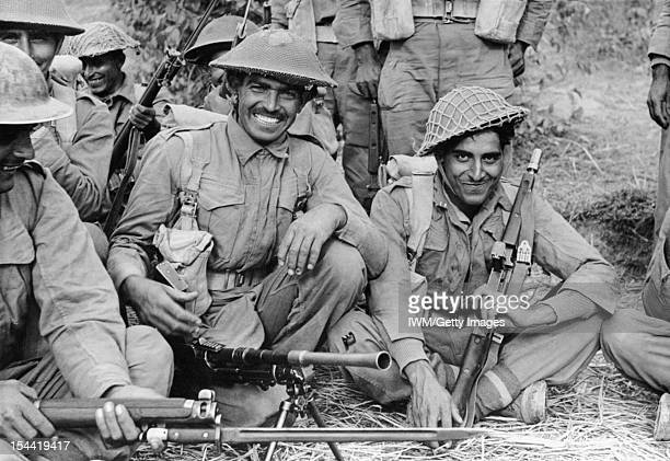 Indian Troops In Burma An Indian infantry section of the 2nd Battalion 7th Rajput Regiment about to go on patrol on the Arakan front Burma circa 1944
