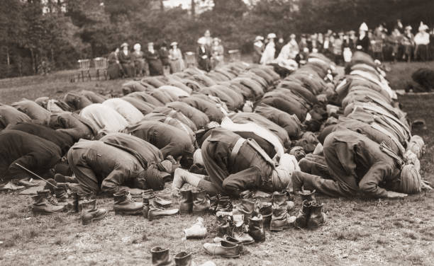 Indian troops serving with the British Army pray outside...