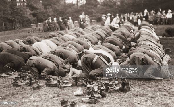 Indian troops serving with the British Army pray outside the Shah Jahan Mosque in Woking, Surrey, during the Muslim festival of Baqrid, or Eid...