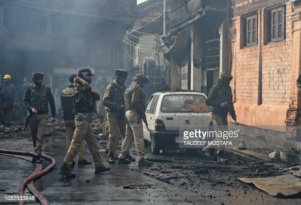 TOPSHOT Indian troops stands at the site were a gun battle took place between suspected militants and Indian government forces in downtown Srinagar...