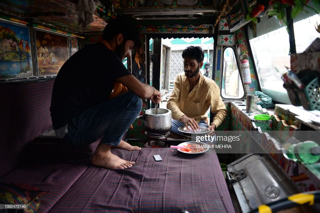 Indian truck driver prepare food inside truck during a nation wide indefinite strike called by truck owners against increasing fuel and toll prices...