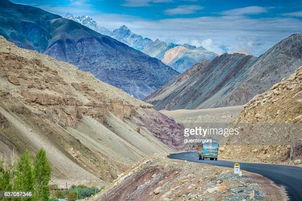 indian truck on the srinagar-leh highway in ladakh, india - kashmir stock photos and pictures