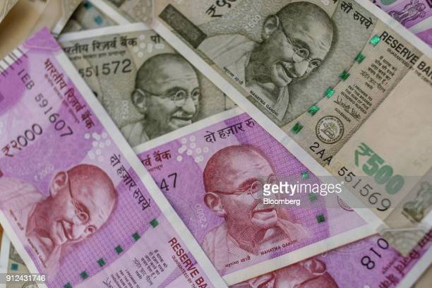 Indian two thousand and five hundred rupee banknotes are arranged for a photograph in Mumbai, India, on Tuesday, Jan. 30, 2018. Indian Prime...
