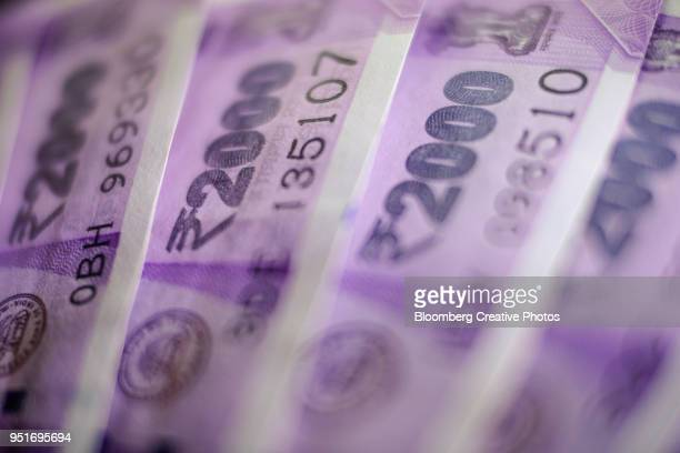 indian two thousand rupee banknotes - 2000 stock pictures, royalty-free photos & images