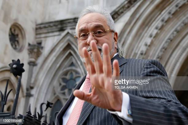 Indian tycoon Vijay Mallya leaves the Royal Courts of Justice, Britain's High Court, in central London on February 11 after attending a hearing into...
