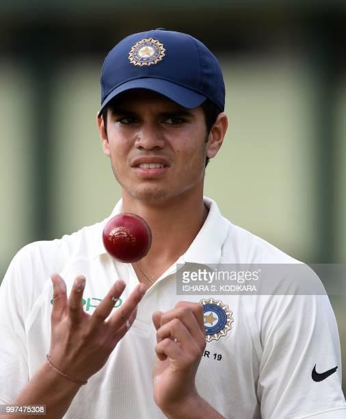 Indian under19 cricketer Arjun Tendulkar son of the Indian former cricket superstar Sachin Tendulkar tosses a ball during a practice session before...