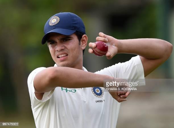 Indian under19 cricketer Arjun Tendulkar son of the Indian former cricket superstar Sachin Tendulkar holds a ball during a practice session before...