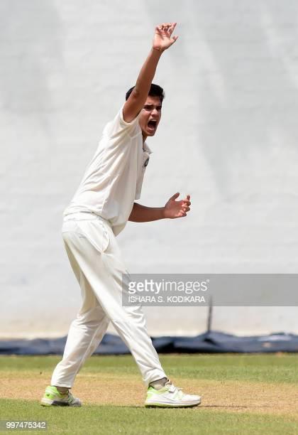 Indian under19 cricketer Arjun Tendulkar son of the Indian former cricket superstar Sachin Tendulkar appeals a decision during a warmup match between...