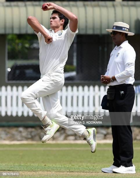 Indian under19 cricketer Arjun Tendulkar son of the Indian former cricket superstar Sachin Tendulkar bowls during a warmup match between the Indian...