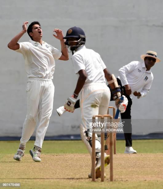 Indian under19 cricketer Arjun Tendulkar son of the Indian former cricket superstar Sachin Tendulkar reacts during a warmup match between the Indian...