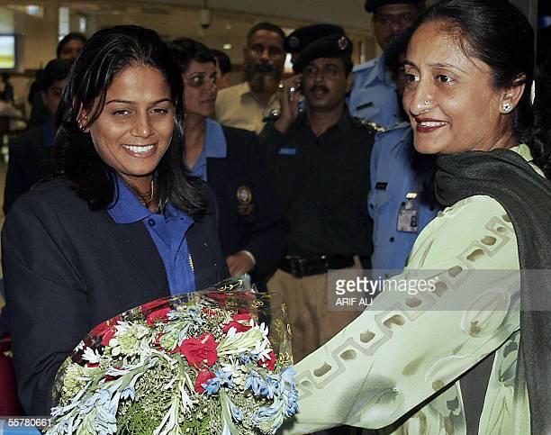 Indian under21 women cricket team captain Karuna Jain Vijaykumar receives a bouquet flowers from Pakistan women cricket team captain Shamsa Hashmi on...