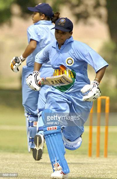 Indian under21 women cricket team players Shweta Rohidas Jadhav and Anagha Arun Deshpande run between wickets in the first oneday match between...