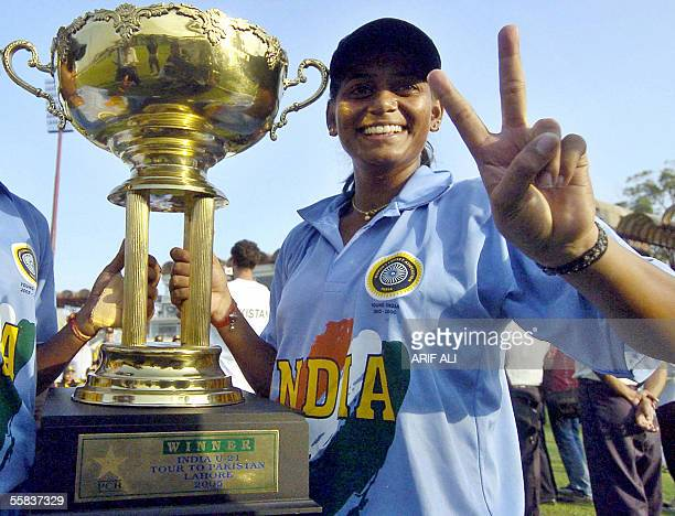 Indian under21 women's cricket team captain Karuna Jain Vijaykumar shows a victory sign as she holds the winning trophy for the four oneday...