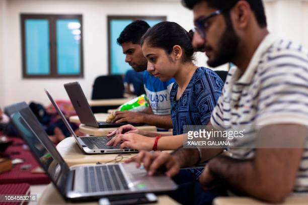 Indian undergraduate students code on their computers as they take part in HackCBS, a 24 hour event of software development also called 'hackathon',...