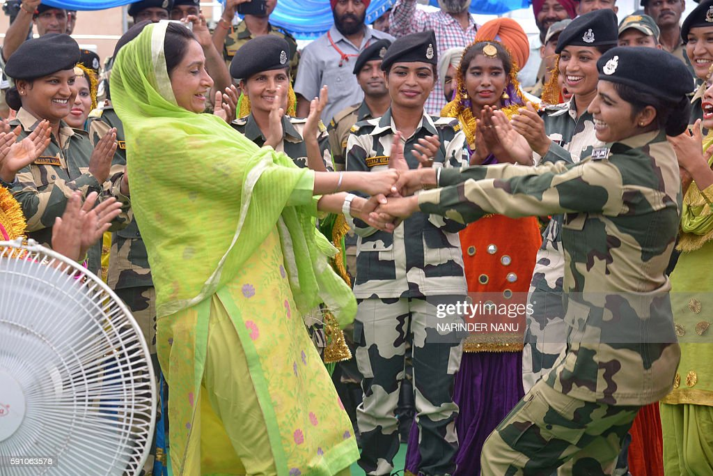 Indian Union Minister for Food Processing Industries Harsimrat Kaur Badal performs the Punjabi dance the `giddha` with Indian Border Security Force...