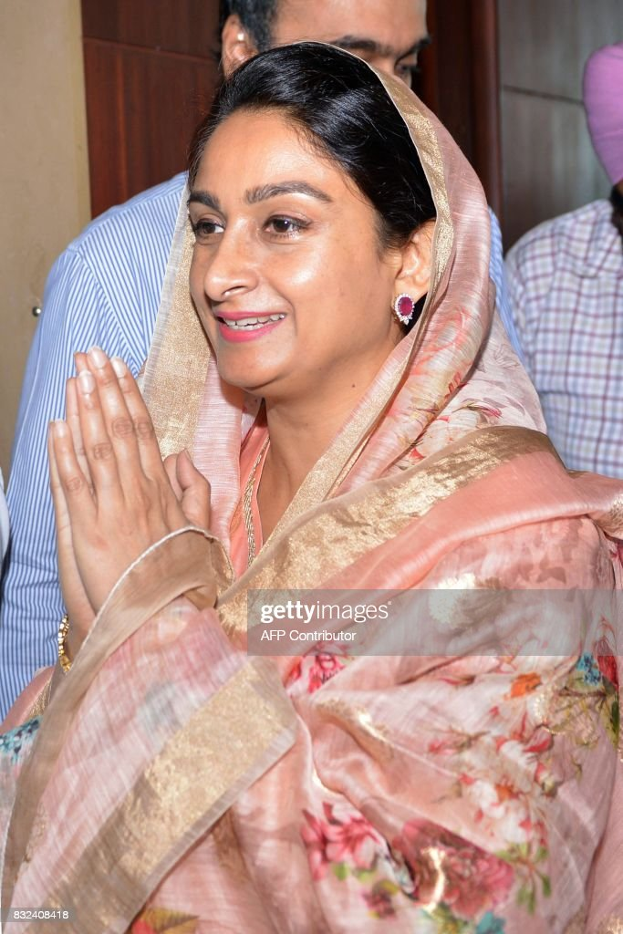 Indian Union Minister for Food Processing Industries Harsimrat Kaur Badal gestures as she arrives for a meeting with industry heads and farmers on...