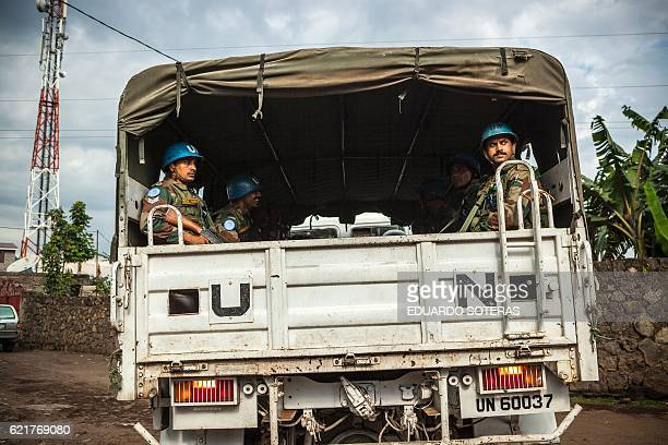 Indian United Nations Organisation Stabilisation Mission in the Democratic Republic of Congo Blue Helmet peacekeepers look on from a United Nations...