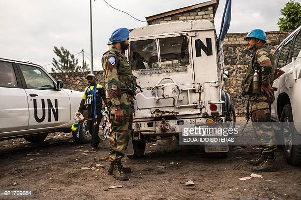 Indian United Nations Organisation Stabilisation Mission in the Democratic Republic of Congo Blue Helmet peacekeepers stand guard next to United...