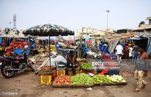 Indian vegetable vendors wait for customers as they start their business after Cyclone Fani in Puri on May 5 2019 Cyclone Fani one of the biggest to...
