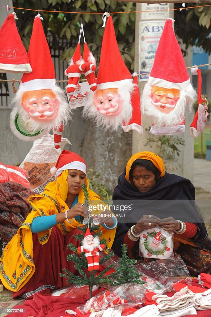 Indian vendors prepare decorative items for Christmas by a roadside in Amritsar on December 22 2014 Although Indian Christians make up a mere two...