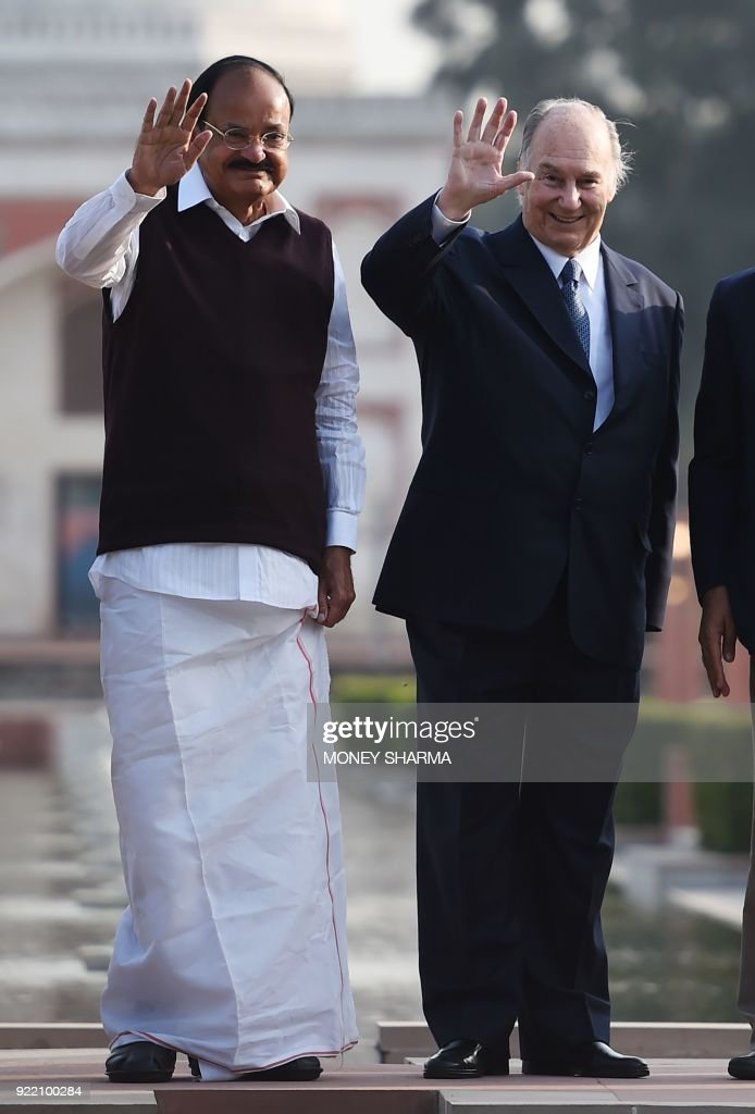 Indian Vice-President Venkaiah Naidu and Prince Karim Aga Khan IV (L) wave during the inauguration of Sunder Nursery, a 16th-century heritage garden complex adjacent to Indian UNESCO site Humayun's Tomb, in New Delhi on February 21, 2018. A once-forgotten Mughal garden in the heart of New Delhi will reopen on February 21 after years of painstaking conservation work, creating a new public park in India's sprawling and smog-choked capital. /