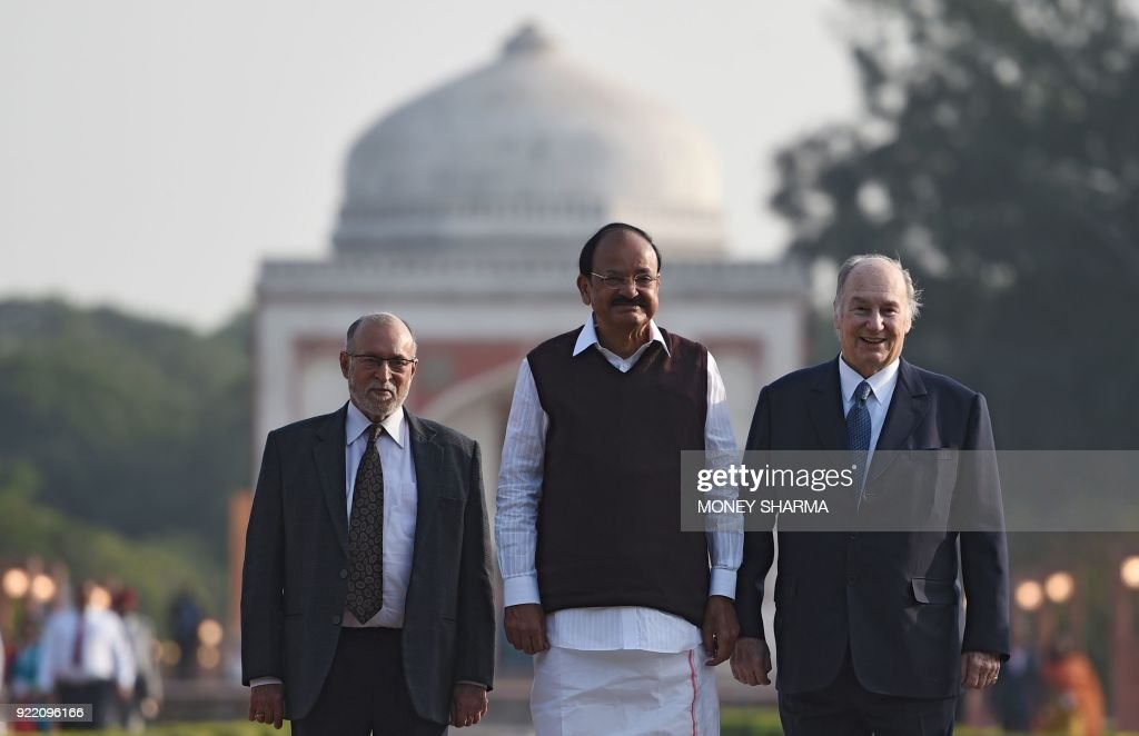 Indian Vice-President Venkaiah Naidu (C), Lieutenant Governor of Delhi Anil Baijal (L) and Prince Karim Aga Khan IV (R) pose for a photograph during the inauguration of Sunder Nursery, a 16th-century heritage garden complex adjacent to Indian UNESCO site Humayun's Tomb, in New Delhi on February 21, 2018. A once-forgotten Mughal garden in the heart of New Delhi will reopen on February 21 after years of painstaking conservation work, creating a new public park in India's sprawling and smog-choked capital. /