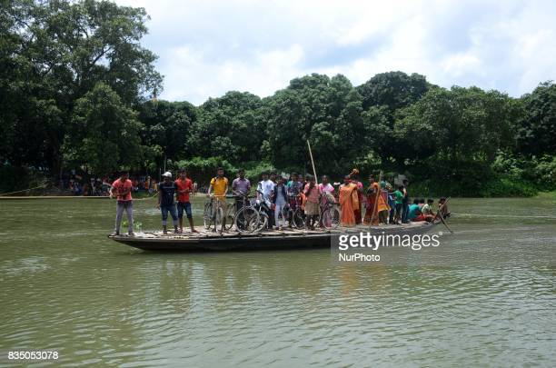 Indian villagers are on their way to the remote villages crossing the river by boat in Nadia district 95 km from Kolkata India on Friday 18th August...
