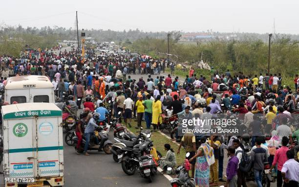 Indian villagers block the national highway connecting Puri to Bhubaneswar as they demand relief materials on the outskirts of Puri on May 5 2019 The...