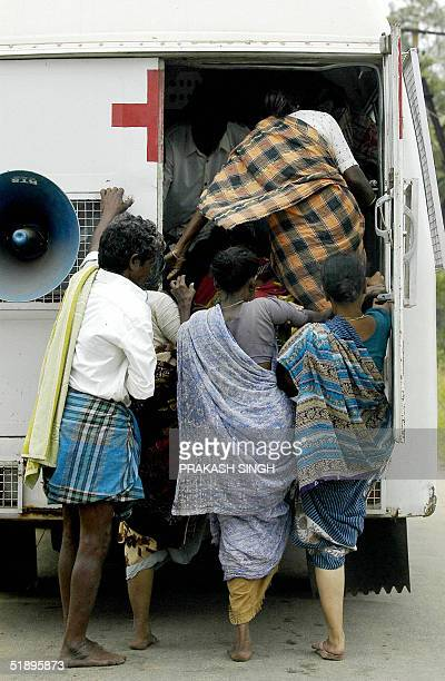 Indian villagers board an ambulance carrying their belongings as they flee from their homes in the village of Talangudaye in Cuddaloresome 185 kms...