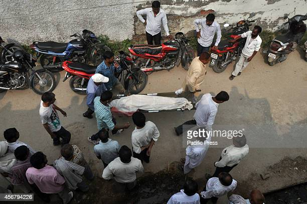 Indian villagers carry the dead body of a girl, reported to have been killed along with three other members of her family in cross-border firing...