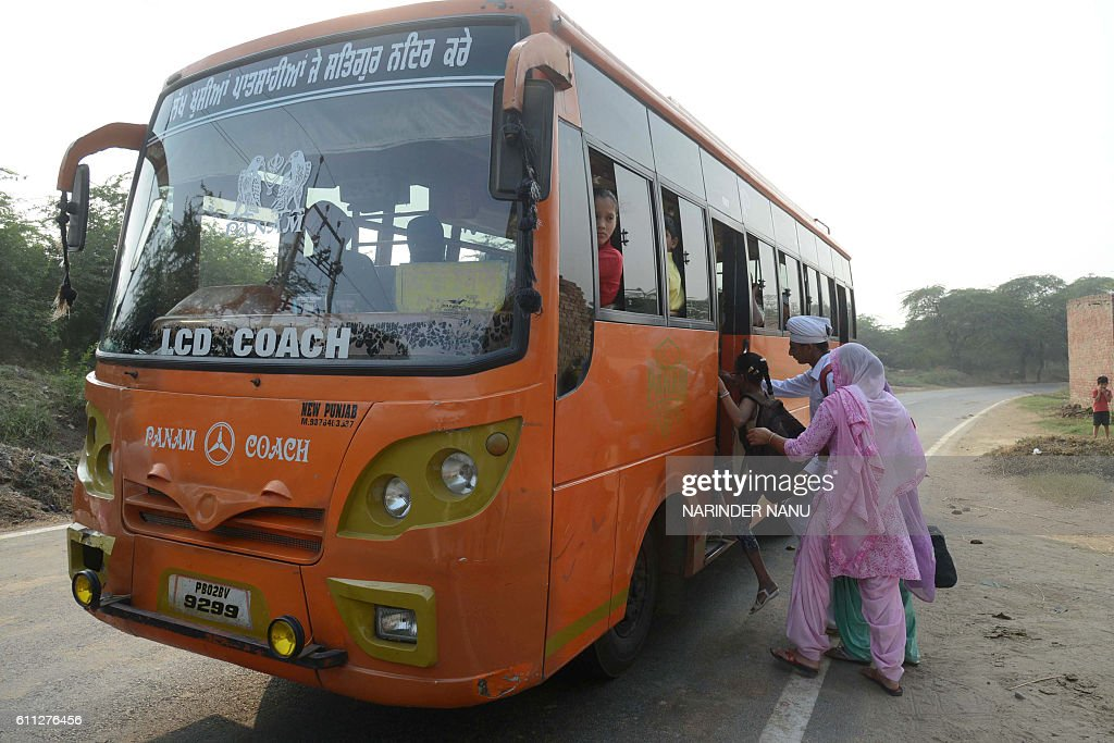 Indian villagers from the IndiaPakistan border area board the bus as they evacuate from the border village of Neshta about 35 kms from Amritsar on...
