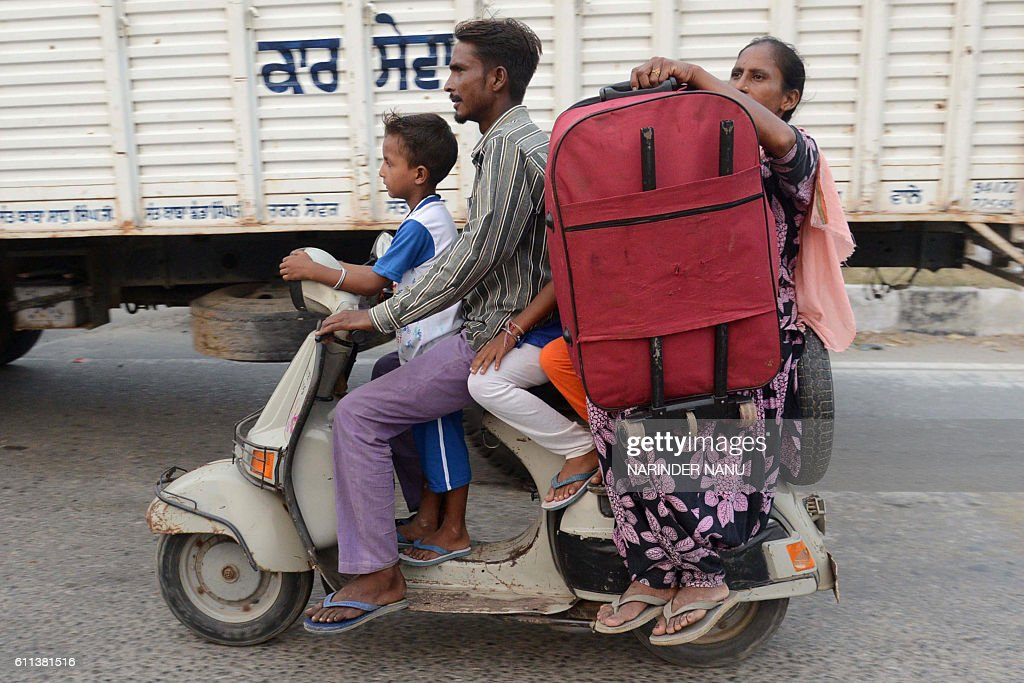 Indian villagers from the IndiaPakistan border area evacuate from a border village about 35 kms from Amritsar on September 29 after the Punjab state..