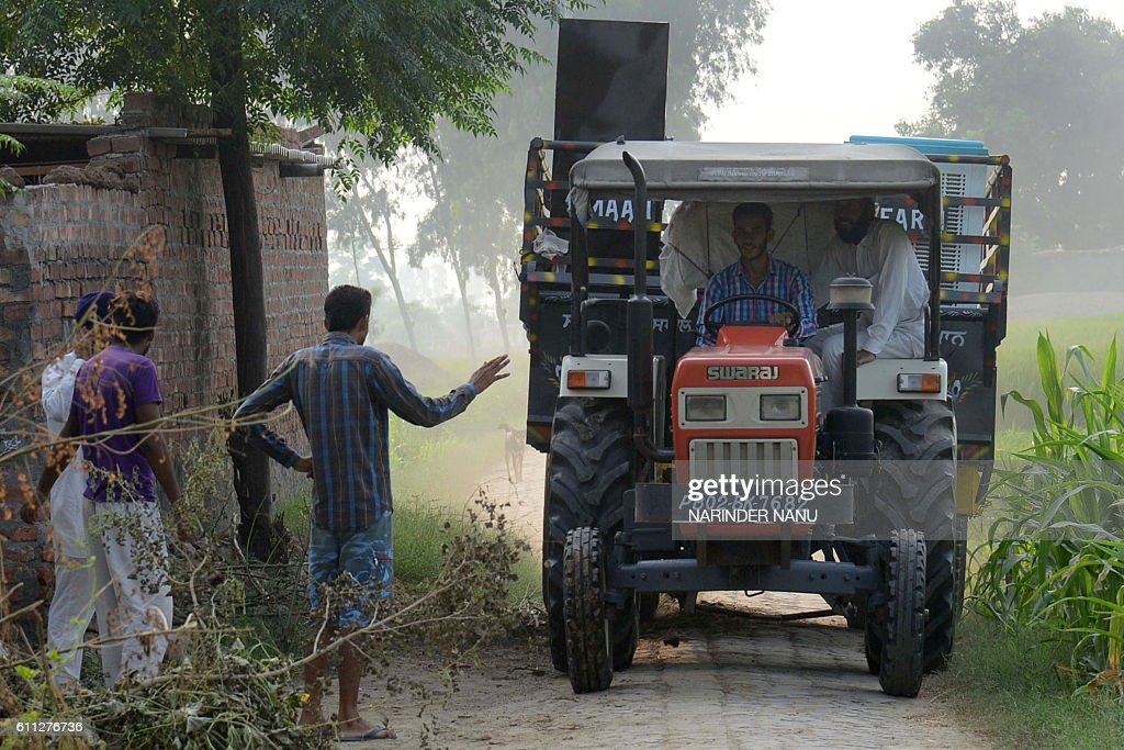 Indian villagers from the IndiaPakistan border area ride on a tractor as they evacuate from a border village near Mahawa about 40 kms from Amritsar...