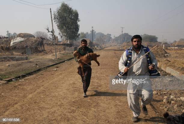Indian villagers run following shelling across the IndiaPakistan border in Jhora village about 37km from Jammu on January 20 2018 Tensions escalated...