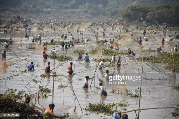 TOPSHOT Indian villagers take part in a community fishing event during the Bhogali Bihu celebrations at Goroimari Lake in Panbari some 50 kms from...