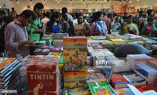 Indian visitors browse books at a stalls in the 40th Kolkata International Book Fair at the Milan Mela Ground