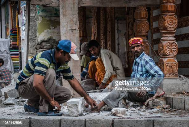 Indian voluntary workers building temple in Manali