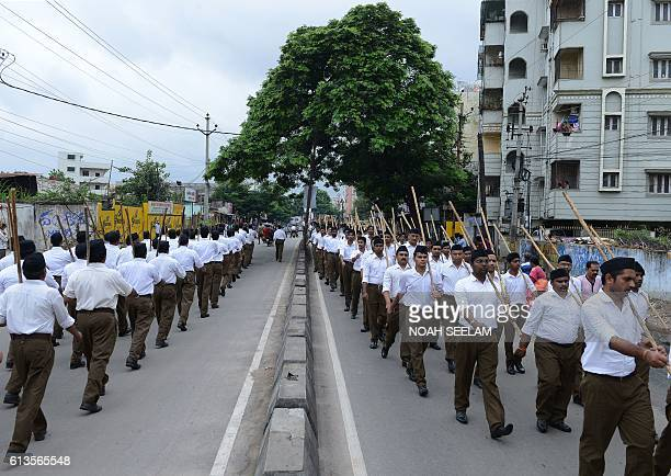 Indian volunteers of the right wing Rashtriya Swayamsevak Sangh organisation wearing a new dress code take part in a march ahead of the Vijaydashmi...