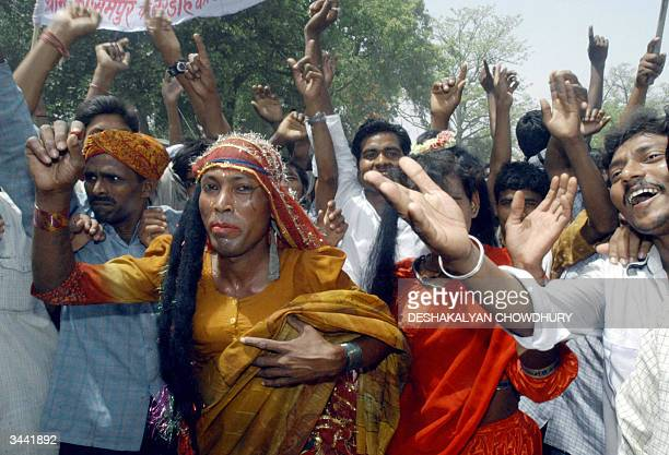 Indian voters dance along with eunichs as they take part in an election rally at Islampur, some 40 Kms south of the capital of the Indian state of...
