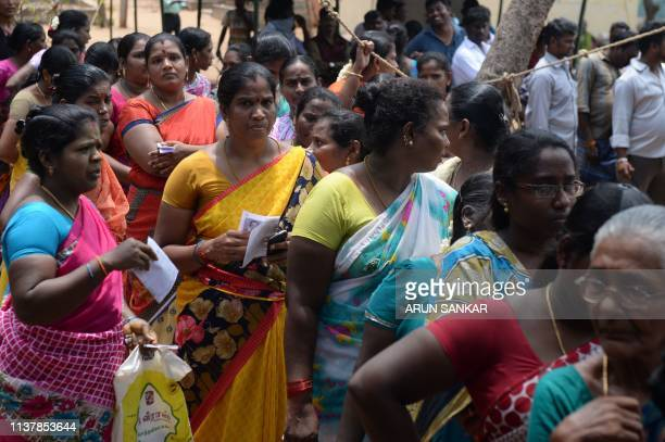 Indian voters queue at a polling station in Chennai on April 18 during the second phase of the mammoth Indian elections More than 157 million of the...