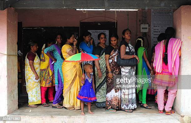 Indian voters queue at a polling station in Chennai on May 16 during voting in state assembly elections in the southern Indian state of Tamil Nadu...