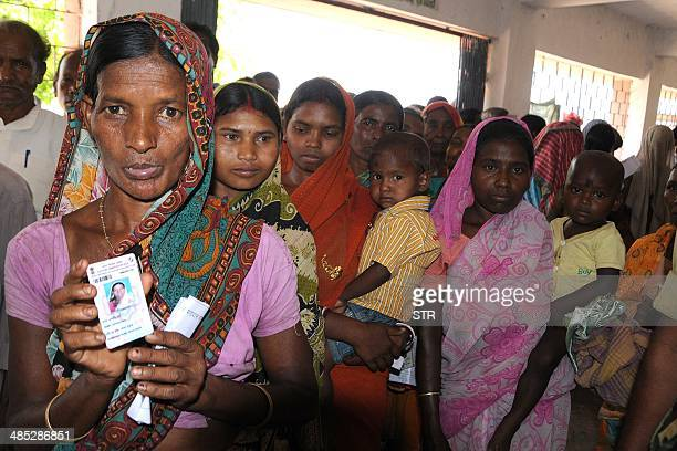 Indian voters queue outside a polling station in Bundu in Jharkhand state on April 17 2014 India hosted its biggest day of voting with the ruling...