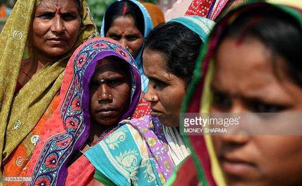Indian voters queue to cast their ballots at a voting centre in the village of Mahmoodpur in Samstipur district on October 12 2015 The first of five...