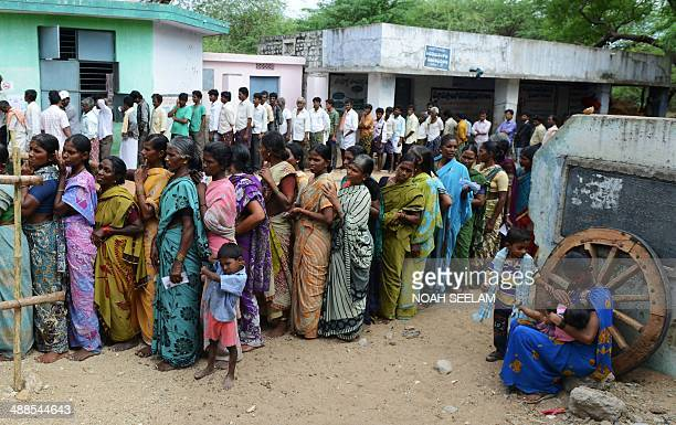 Indian voters queue to cast their ballots in Veldurthi Mandal in the district of Kurnool some 250 kms from Hyderabad on May 7 2014 More than 95...