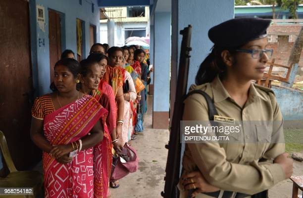 Indian voters queue to cast their votes at a polling station for Panchayet elections at Chopra village in West Bengal on May 14 2018 West Bengal...