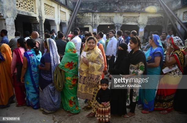 Indian voters queue to cast their votes at a polling station in Allahabad on November 26 during the second phase of local municipal elections in the...