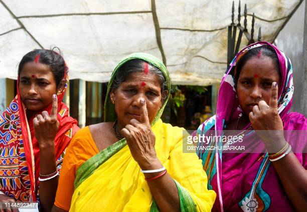 Indian voters show their inkmarked fingers after casting their vote in the Ghoramara island around 110 km south of Kolkata on May 19 during the 7th...