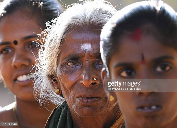 Indian voters stand in a queue at a polling station to cast their vote in Hosur in the southern state of Tamil Nadu on May 13 2009 India voters cast...