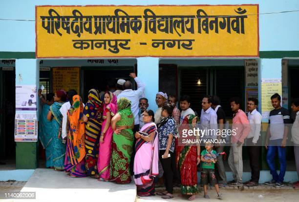 Indian voters stand in a queue to cast their vote at a polling station in Kanpur on April 29 2019 Voting began for the fourth phase of India's...