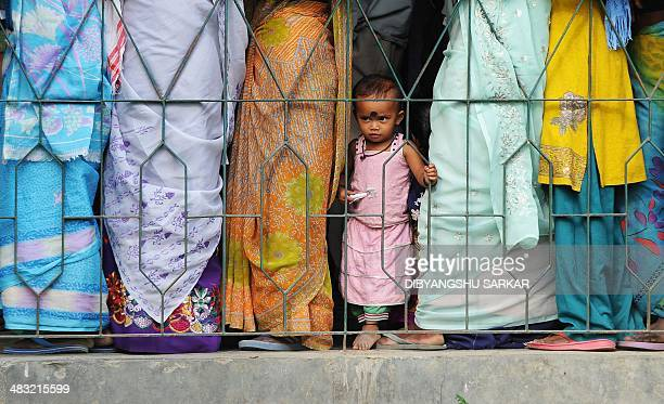 Indian voters wait in line outside a polling station in Dibrugarh on April 7 2014 Indians have begun voting in the world's biggest election which is...